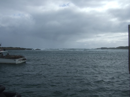wave breaking into the harbour